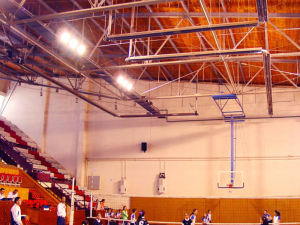 Installation of radiant heaters as part of a sports hall heating project