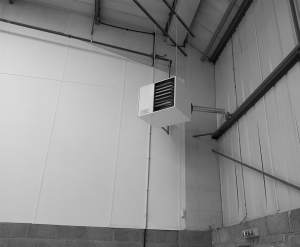 suspended heater installation into warehouse